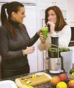 Dr Ginger helping a patient drink her green juice
