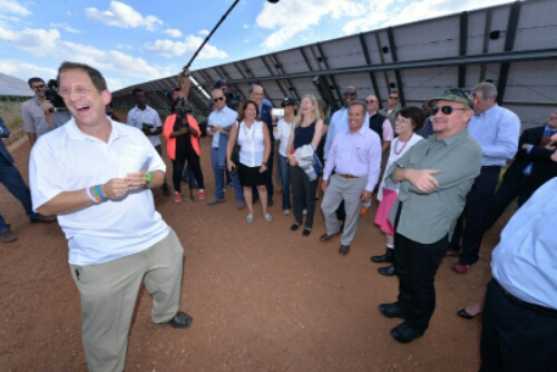 Yosef Abramowitz says that 100% of the day-time energy needs of Israel, the Palestinians, and Africa can be powered by the sun. Here sharing a light moment in Rwanda with U2's Bono, at East Africa's first commercial scale solar field.