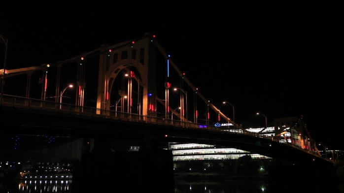 Sustainability and innovation are highlighted in Pittsburgh this holiday season as one of the city's famed bridges is awash in light and colors thanks to the Energy Flow bridge lighting installation, powered in part by wind energy. Photo credit: Roy Engelbrecht Pittsburgh Bicentennial