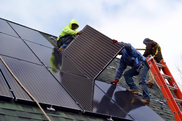 A solar installation crew hard at work in New York – photo courtesy of Kasselman Solar