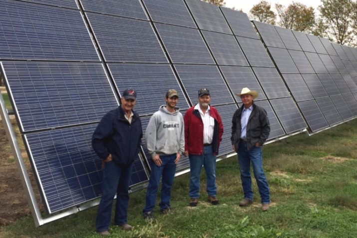 Jim Knopik (left) and North Star Solar Bears solar installers with farmer Rick Hammond (right) and his 25 kW solar array near Benedict, NE. (Photo: Mary Anne Andrei)